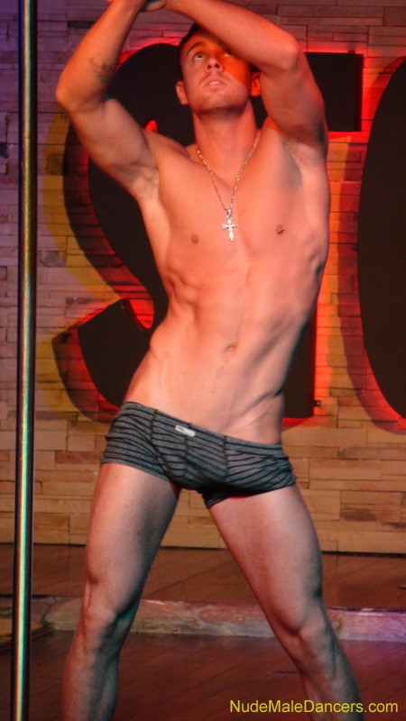 Hot muscle guy performing strip show